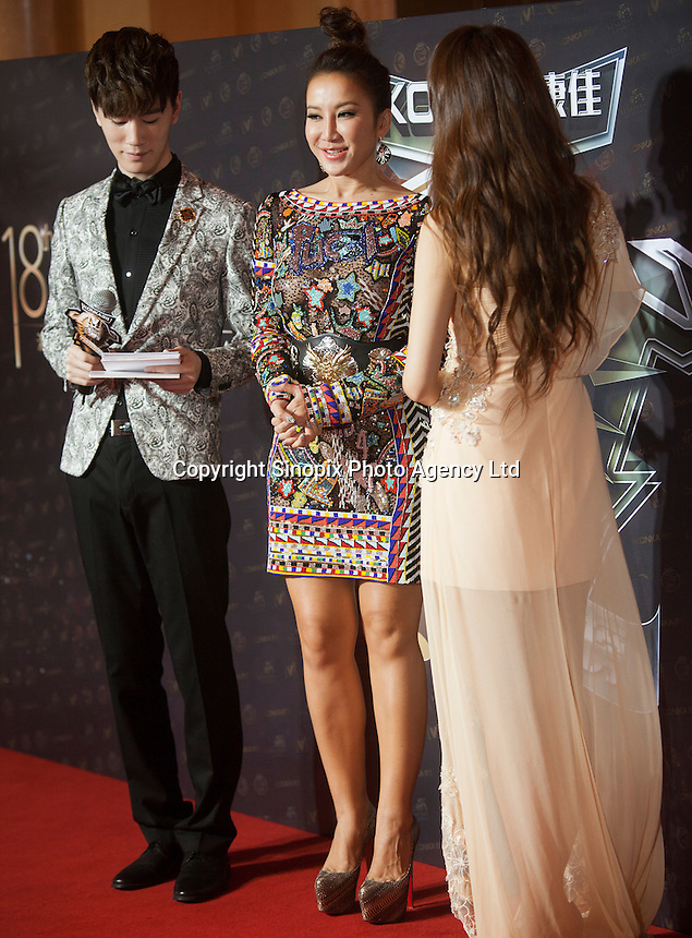 Coco Lee (C) from Hong Kong, winner of the Most Stylish Asian Singer Award, is seen on the red carpet at the 18th Channel [V] China Music Awards and Asian Influential Power Grand Ceremony at the Venetian Macau Casino in Macau, China, 23 April 2014