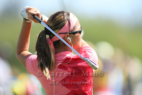 February 16, 2006 - Kahuku, HI - Jennifer Rosales listens to her iPod while hitting balls on the practice range before Round 1 of the LPGA SBS Open at Turtle Bay Resort...Photo: Darrell Miho