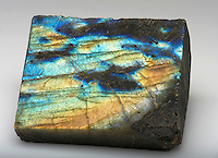 An iridescent slab of labradorite, a feldspar mineral of the plagioclase series consisting of sodium calcium aluminium silicate. Madagascar, Africa.