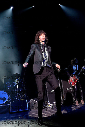 PRIMAL SCREAM - vocalist Bobby Gillespie - performing live at the Academy in Brixton London UK - 11 Dec 2013.  Photo credit: George Chin/IconicPix