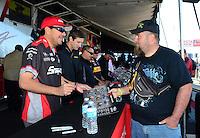 Oct. 27, 2012; Las Vegas, NV, USA: NHRA funny car driver Cruz Pedregon during qualifying for the Big O Tires Nationals at The Strip in Las Vegas. Mandatory Credit: Mark J. Rebilas-