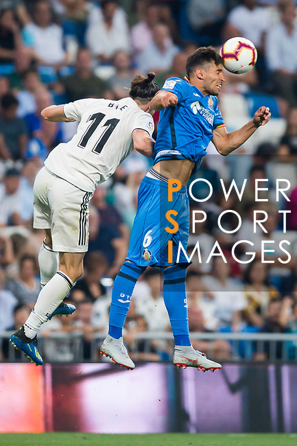 Leandro Cabrera Sasia of Getafe CF fights for the ball with Gareth Bale of Real Madrid during the La Liga 2018-19 match between Real Madrid and Getafe CF at Estadio Santiago Bernabeu on August 19 2018 in Madrid, Spain. Photo by Diego Souto / Power Sport Images