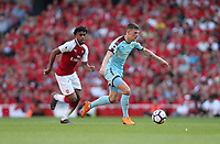 Burnley's Johann Gudmundsson gets away from Arsenal's Alex Iwobi<br /> <br /> Photographer Rob Newell/CameraSport<br /> <br /> The Premier League - Arsenal v Burnley - Sunday 6th May 2018 - The Emirates - London<br /> <br /> World Copyright &copy; 2018 CameraSport. All rights reserved. 43 Linden Ave. Countesthorpe. Leicester. England. LE8 5PG - Tel: +44 (0) 116 277 4147 - admin@camerasport.com - www.camerasport.com