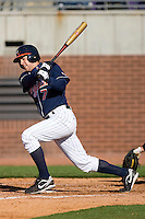 John Barr #7 of the Virginia Cavaliers follows through on his swing versus the East Carolina Pirates at Clark-LeClair Stadium on February 20, 2010 in Greenville, North Carolina.   Photo by Brian Westerholt / Four Seam Images