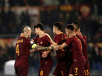 Calcio, Serie A: Roma vs ChievoVerona. Roma, stadio Olimpico, 22 settembre 2016.<br /> Roma&rsquo;s Diego Perotti celebrates with teammates after scoring on a penalty kick during the Italian Serie A football match between Roma and Chievo Verona, at Rome's Olympic stadium, 22 December 2016.<br /> UPDATE IMAGES PRESS/Isabella Bonotto