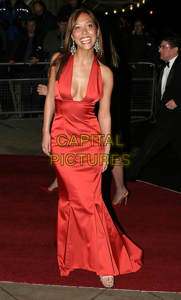 MYLEENE KLASS.Cirque Du Soleil charity performance at the Royal Albert Hall and aftershow dinner at the V&A Museum.5 February 2004.full length, full-length, long halterneck red satin dress, cleavage, plunging neckline, pin, badge.www.capitalpictures.com.sales@capitalpictures.com.© Capital Pictures.