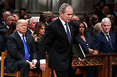 Former President George W. Bush walks past President Donald Trump, first lady Melania Trump, Michelle Obama and former President Bill Clinton to give a eulogy for his father, former President George H.W. Bush during the State Funeral at the National Cathedral, Wednesday, Dec. 5, 2018, in Washington. <br /> Credit: Alex Brandon / Pool via CNP