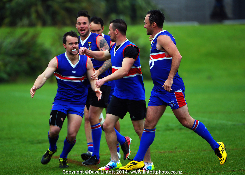 The Bulldogs celebrate a goal during the Wellington Australian Rules Football club final match between the Bulldogs and North City Demons at Hutt Park, Wellington, New Zealand on Saturday, 22 November 2014. Photo: Dave Lintott / lintottphoto.co.nz