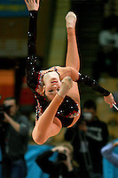 "Anna Bessonova of Ukraine performs cossack leap with ribbon at 2007 World Cup Kiev, ""Deriugina Cup"" in Kiev, Ukraine on March 17, 2007. Anna won the seniors All-Around."