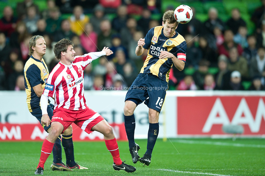 MELBOURNE, AUSTRALIA - AUGUST 5, 2010: Alex Wilkinson from the Central Coast Mariners heads the ball for a goal in Round 1 of the 2010 A-League between the Melbourne Heart and Central Coast Mariners at AAMI Park on August 5, 2010 in Melbourne, Australia. (Photo by Sydney Low / www.syd-low.com)