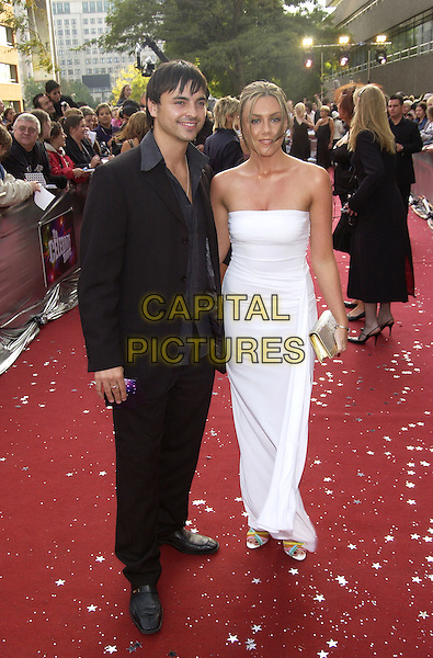 "ANDY SCOTT LEE & MICHELLE HEATON.ITV's ""The Celebrity Awards"".London 26 September 2004.full length, white strapless dress, gold clutch purse, black suit.www.capitalpictures.com.sales@capitalpictures.com.©Capital Pictures"
