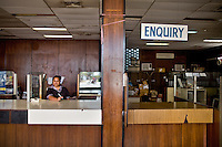 """In 1995, following the collapse of the Bank of Nauru, the country found itself facing a serious financial crisis. There are currently no Bank on Nauru and it's a cash only economy..Calmina waits for customers at the former Bank of Nauru, now the government's """"Department of Payment""""...During the 1990s, it was possible to establish a licensed bank in Nauru for only $25,000 with no other requirements. ..Nauru, officially the Republic of Nauru is an island nation in Micronesia in the South Pacific.  Nauru was declared independent in 1968 and it is the world's smallest independent republic, covering just 21square kilometers..Nauru is a phosphate rock island and its economy depends almost entirely on the phosphate deposits that originate from the droppings of sea birds. Following its exploitation it briefly boasted the highest per-capita income enjoyed by any sovereign state in the world during the late 1960s and early 1970s..In the 1990s, when the phosphate reserves were partly exhausted the government resorted to unusual measures. Nauru briefly became a tax haven and illegal money laundering centre. From 2001 to 2008, it accepted aid from the Australian government in exchange for housing a Nauru detention centre, with refugees from various countries including Afghanistan and Iraq..Most necessities are imported on the island..Nauru has parliamentary system of government. It had 17 changes of administration between 1989 and 2003. In December 2007, former weight lifting medallist Marcus Stephen became the President."""