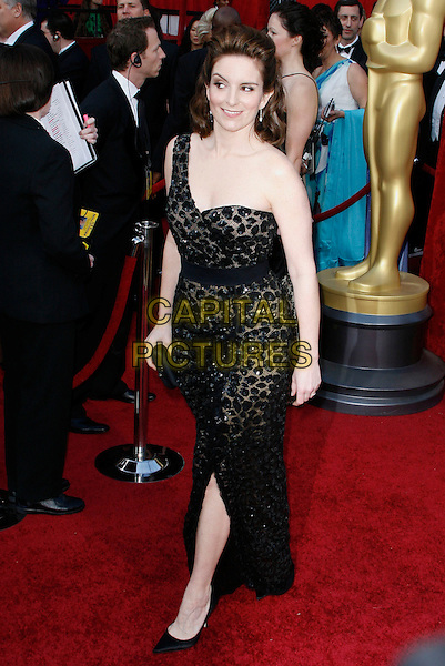 TINA FEY.The 82nd Annual Academy Awards held aat The Kodak Theatre in Hollywood, California, USA..March 7th, 2010.oscars full length one shoulder strap dress black clutch bag beaded patterned pattern sheer shoes slit split sequined sequin.CAP/EAST.©Eastman/Capital Pictures.