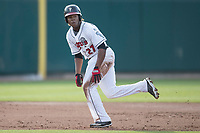 Lansing Lugnuts designated hitter Vladimir Guerrero Jr. (27) runs to third base during the Midwest League baseball game against the Bowling Green Hot Rods on June 29, 2017 at Cooley Law School Stadium in Lansing, Michigan. Bowling Green defeated Lansing 11-9 in 10 innings. (Andrew Woolley/Four Seam Images)