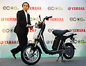 July 14, 2010 - Tokyo, Japan - Yamaha Motor Co. President and Chief Executive Hiroyuki Yanagi stands next to the company's new electric commuter vehicle EC-03 unveiled in Tokyo, Japan, on July 14, 2010. Yamaha Motor will begin selling from September 1 in the Tokyo area and nationwide from October 1, then will introduce the EC-03 in the markets of Taiwan and Europe in 2011.