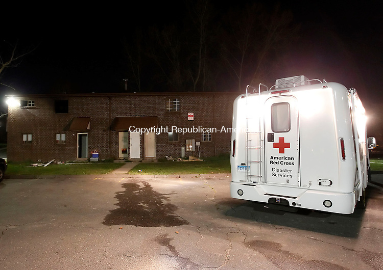 Waterbury, CT- 25 April 2013-042513CM17- An American Red Cross truck is on scene at the Truman Apartment complex in Waterbury after a fire displaced families from three units Thursday night.    Christopher Massa Republican-American