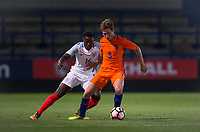 Carel Eiting (Jong Ajax) of Netherlands holds off Ronaldo Vieira (Leeds United) of England U20 during the International friendly match between England U20 and Netherlands U20 at New Bucks Head, Telford, England on 31 August 2017. Photo by Andy Rowland.