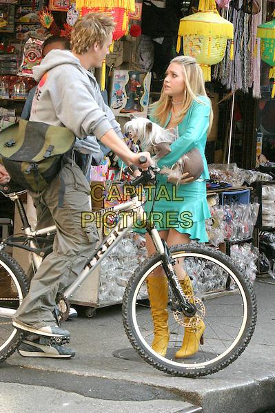 """ASHLEY OLSEN.on the set of """"New York Minute"""", New York City.full length, full-length, yellow knee high boots, green minidress, dog, animal, bike.www.capitalpictures.com.sales@capitalpictures.com.©Capital Pictures."""