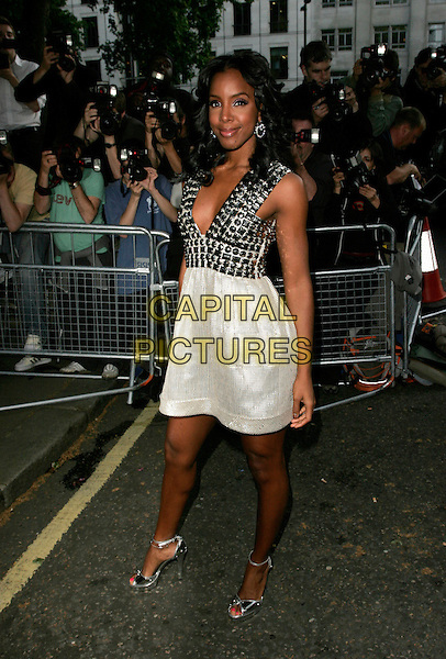 KELLY ROWLAND.Arrivals at the 4th Aunnual Glamour Women Of The Year Awards, Berkely Square Gardens, London, England, .June 5th 2007..full length silver grey studded beaded Burberry dress low cut.CAP/AH.©Adam Houghton/Capital Pictures.