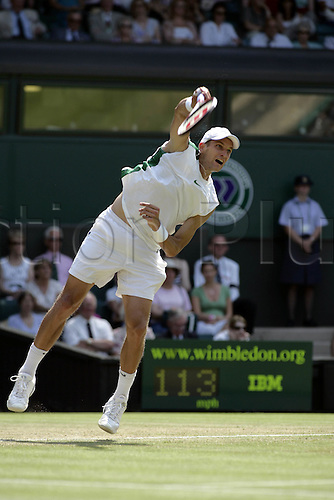 30 June 2006:   Belarus player Max Mirnyi (BLR) serves during his third round men's singles match against Blake on the fifth day at the All England Lawn Tennis Championships, Wimbledon, London. Mirnyi won the match 6-4, 3-6, 4-6, 6-1, 6-0.  Photo: Glyn Kirk /Actionplus...060630 man men male racket serving