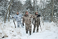 From left, PR and Web Director for the National Wild Turkey Federation Brent Lawrence (cq), Norris Marshall (cq), and OutdoorLife Editor Andrew McKean (cq) talk about what path to follow during a hunt for wild turkey in Nebraska, Saturday, December 3, 2011...Photo by Matt Nager