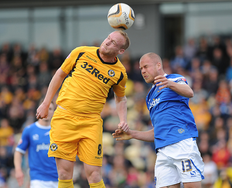 Newport County's Lee Minshull vies for possession with Portsmouth's Johnny Ertl<br /> <br /> Photo by Ashley Crowden/CameraSport<br /> <br /> Football - The Football League Sky Bet League Two - Newport County AFC v Portsmouth - Saturday 29th March 2014 - Rodney Parade - Newport<br /> <br /> &copy; CameraSport - 43 Linden Ave. Countesthorpe. Leicester. England. LE8 5PG - Tel: +44 (0) 116 277 4147 - admin@camerasport.com - www.camerasport.com