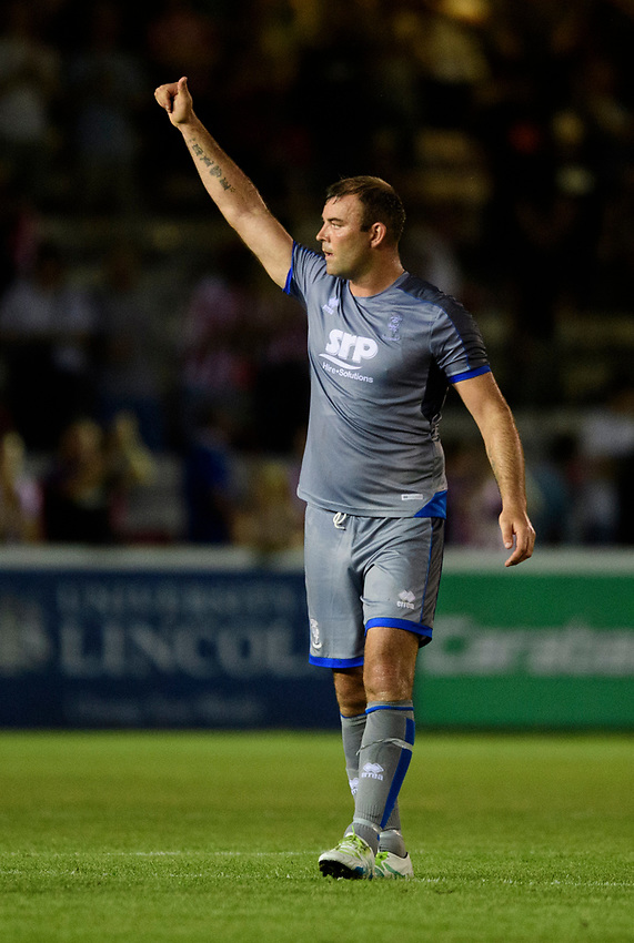 Lincoln City's Matt Rhead applauds the fans at the final whistle<br /> <br /> Photographer Chris Vaughan/CameraSport<br /> <br /> Football Pre-Season Friendly - Lincoln City v Stoke City - Wednesday July 24th 2019 - Sincil Bank - Lincoln<br /> <br /> World Copyright © 2019 CameraSport. All rights reserved. 43 Linden Ave. Countesthorpe. Leicester. England. LE8 5PG - Tel: +44 (0) 116 277 4147 - admin@camerasport.com - www.camerasport.com
