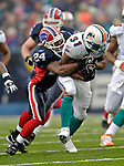17 December 2006: Miami Dolphins running back Sammy Morris (31) is tackled by Buffalo Bills cornerback Terrence McGee (24) at Ralph Wilson Stadium in Orchard Park, New York. The Bills defeated the Dolphins 21-0.. .Mandatory Photo Credit: Ed Wolfstein Photo<br />