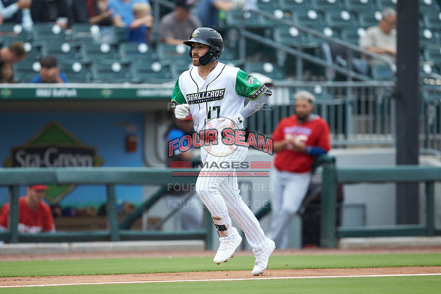 Danny Mendick (17) of the Caballeros de Charlotte jogs towards home plate after hitting a home run against the Buffalo Bisons at BB&T BallPark on July 23, 2019 in Charlotte, North Carolina. The Bisons defeated the Caballeros 8-1. (Brian Westerholt/Four Seam Images)