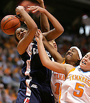 KNOXVILLE, TN--07 JANUARY 2005- 010706JS06-<br /> UConn's Brittany Hunter gets her shot blocked by  Tennessee's Tey'Sha Fluker (50) while teammate Shanna Zolman (5) and Candace Parker, back, help out on the play during their game Saturday at the Thompson-Boling Arena in Knoxville, Tennessee. <br />  --Jim Shannon Republican American--UConn; Tennessee; Thompson-Boling Arena; Knoxville; Tennessee; Tey'Sha Fluker; Brittany Hunter, Shanna Zolman, Candace Parker are CQ