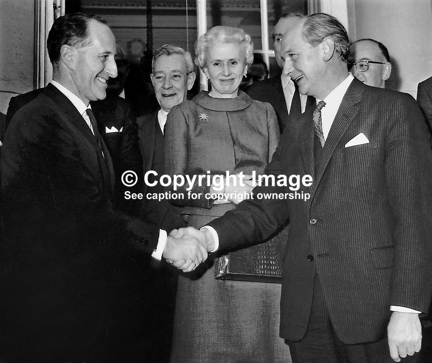 Capt Terence O'Neill, Prime Minister of N Ireland (left) welcomes Jack Lynch, Rep of Ireland Prime Minister, to Parliament Buildings, Stormont, Belfast. Also in the photo is Mrs Terence O'Neill. O'Neill later became a UK Life Peer, Lord O'Neill of the Maine. Ref: 19671211001.<br />