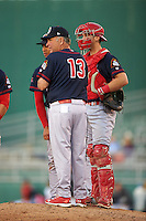 Peoria Chiefs manager Joe Kruzel (13) makes a pitching change with catcher Steve Bean (8) during a game against the Lansing Lugnuts on June 6, 2015 at Cooley Law School Stadium in Lansing, Michigan.  Lansing defeated Peoria 6-2.  (Mike Janes/Four Seam Images)