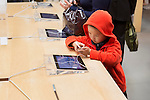 Child using iPhone at Apple store in Ginza, Tokyo, Japan 2014