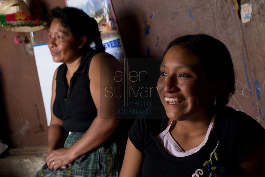 Alma de Los Angeles Sambrano Montufa, 15, sits with her mother, Miriam Violeta Montufa, in their home in Chimaltenango, Guatemala on Thursday, March 8, 2007. Alma worked at Legumex, a vegetable and fruit company that exports to the United States, for a year and a half. Her mother also used to work at the plant, but can no longer work due to an illness. Both Alma and her mother say they know for certain that the plant hires underage workers for sometimes 14-hour shifts.