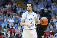 CHAPEL HILL, NC - FEBRUARY 25: Cole Anthony #2 of the University of North Carolina dribbles the ball during a game between NC State and North Carolina at Dean E. Smith Center on February 25, 2020 in Chapel Hill, North Carolina.