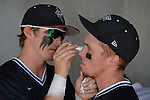 4 JUNE 2016: Nova Southeastern University players apply eye black before they take the field during the Division II Men's Baseball Championship between Millersville University and Nova Southeastern University at the USA Baseball National Training Complex in Cary, NC.  Nova Southeastern University defeated Millersville University 8-6 to win the national title. Grant Halverson/NCAA Photos