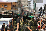 Palestinian Hamas militants attend the funeral of Nidal al-Jaafari, a 28-year-old field commander who was killed overnight in a suicide attack that targeted forces near the Gaza Strip's crossing with Egypt, in Rafah, southern Gaza Strip August 17, 2017. Photo by Ashraf Amra