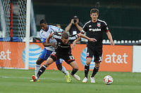 Washington D.C. - May 17, 2014: Perry Kitchen (23) of D.C. United shields the ball from Patrice Bernier (8) of Montreal Impact.   D.C. United tied the Montreal Impact 1-1 during a Major League Soccer match for the 2014 season at RFK Stadium.