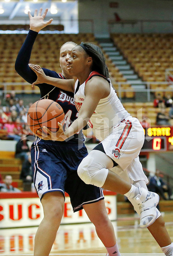 Kelsey Mitchell (3) of the Ohio State Buckeyes works around Kadri-Ann Lass (42) of the Duquesne Lady Dukes during the Buckeyes' home opener at St. John Arena on Friday, November 11, 2016. Ohio State led 46-26 at halftime. (Barbara J. Perenic/The Columbus Dispatch)