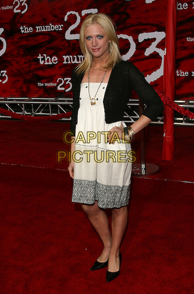 "BRITTANY SNOW.Attends The Newline Cinema L.A. Premiere of .""The Number 23"" held at The Orpheum Theatre in .Los Angeles, California, USA, February 13th 2007..full length black cardigan hand on hip white dress.CAP/DVS.©Debbie VanStory/Capital Pictures"