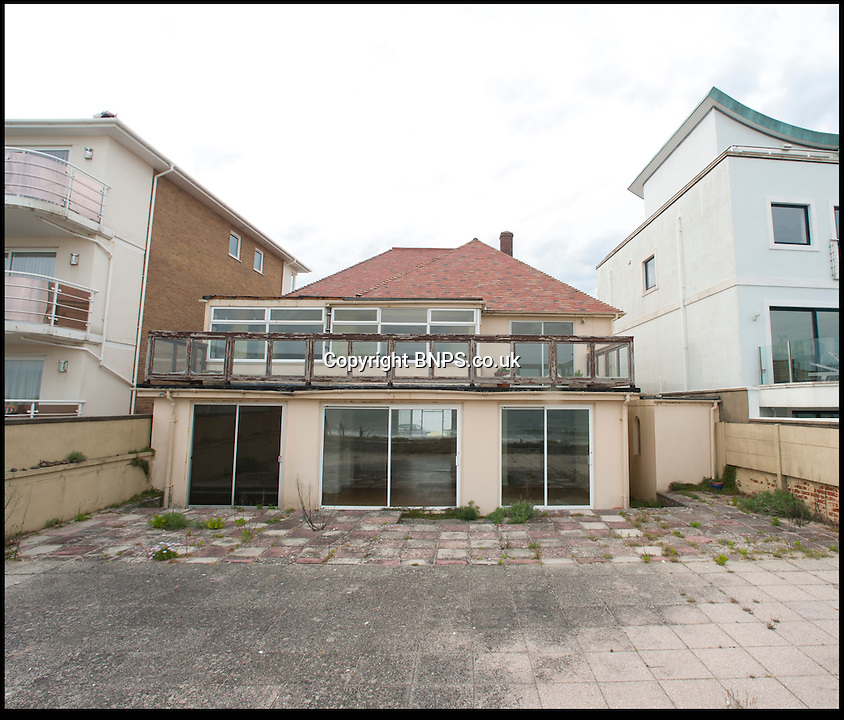BNPS.co.uk (01202) 558833<br /> Picture: Peter Willows<br /> <br /> The house on Banks Road, Poole, Dorset.<br /> <br /> This run-down house in desperate need of repair has sold for nearly &pound;3.5million to set a record for the millionaire's resort of Sandbanks. The price paid for the shabby home on the sandy peninsular in Poole, Dorset, equates to &pound;1,725 per square foot. But the unnamed couple who have bought the pile are more interested in the two-way views of picturesque Poole Harbour from the front and the sea to the rear. The property is one of the last of its type on the exclusive peninsula that has yet to be bought up and developed.<br /> <br /> Sandbanks is rated at the fifth most expensive location in the world to buy property, with only Manhatten, Tokyo, Hong Kong and London ahead of it. Estate agents have described the deal as a 'sensible price'.