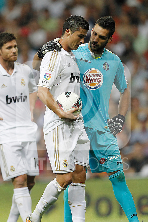 Real Madrid's Cristiano Ronaldo and Miguel Angel Moya  and Getafe's during La Liga match on september 10th 2011...Photo: Cesar Cebolla / ALFAQUI