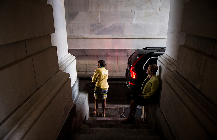 UNITED STATES - JULY 28: Rep. Rosa DeLauro, D-Conn., left, and Rep. Kay Granger, R-Texas, wait for their rides under the carriage entrance during a rain storm following the final votes as Congress leaves town for their summer recess on Friday, July 28, 2017. (Photo By Bill Clark/CQ Roll Call)