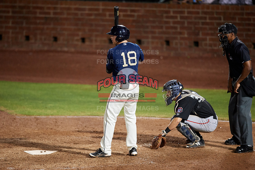 Mobile BayBears second baseman Connor Justus (18) at bat in front of catcher Brian Olson (30) and home plate umpire Edwin Moscoso during a game against the Chattanooga Lookouts on May 5, 2018 at Hank Aaron Stadium in Mobile, Alabama.  Chattanooga defeated Mobile 11-5.  (Mike Janes/Four Seam Images)