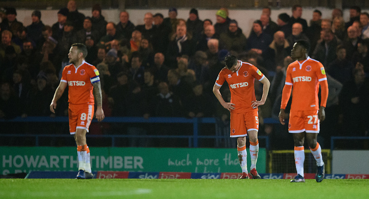 Blackpool players, from left, Jay Spearing, Paudie O'Connor and Marc Bola react after Rochdale's second goal, scored by Rochdale's Ian Henderson<br /> <br /> Photographer Chris Vaughan/CameraSport<br /> <br /> The EFL Sky Bet League One - Rochdale v Blackpool - Wednesday 26th December 2018 - Spotland Stadium - Rochdale<br /> <br /> World Copyright © 2018 CameraSport. All rights reserved. 43 Linden Ave. Countesthorpe. Leicester. England. LE8 5PG - Tel: +44 (0) 116 277 4147 - admin@camerasport.com - www.camerasport.com