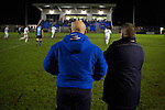 Bishop Auckland 3 West Auckland Town 1, 22/01/2016. Heritage Park, Northern League Division One. The home team manager Steve Riley (right) and his assistant Nathan Haslamd watching the action as Bishop Auckland (in blue) take on West Auckland Town in a Northern League division one match at Heritage Park. Bishop Auckland were winners of the Amateur Cup 10 times between 1895 and 1957 whilst their opponents won the Sir Thomas Lipton Trophy, regarded as the first world club tournament, in 1909 and 1911.  Bishop Auckland won this fixture 3-1, watched by a crowd of 422 at the ground they moved into in 2010. Photo by Colin McPherson.