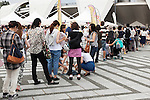 Visitors wait patiently in line to taste various flavours of gelato ice cream during the Gelato World Tour on September 5, 2015, Tokyo, Japan. Over 3 days visitors to the Tokyo event can taste 16 flavours of gelato and will chose the top three flavours to represent the Far East Asia region at the Grand Finale of Gelato World Tour 2.0 to be held in Rimini, Italy in 2017. (Photo by Rodrigo Reyes Marin/AFLO)