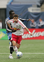 New York Red Bulls' Sinisa Ubiparipovic (8) is grabbed from behind by San Jose Earthquakes' Kei Kamara (16) in the first half of an MLS soccer match at Giants Stadium in East Rutherford, N.J. on Sunday, April 27, 2008. The Red Bulls defeated the Earthquakes 2-0.