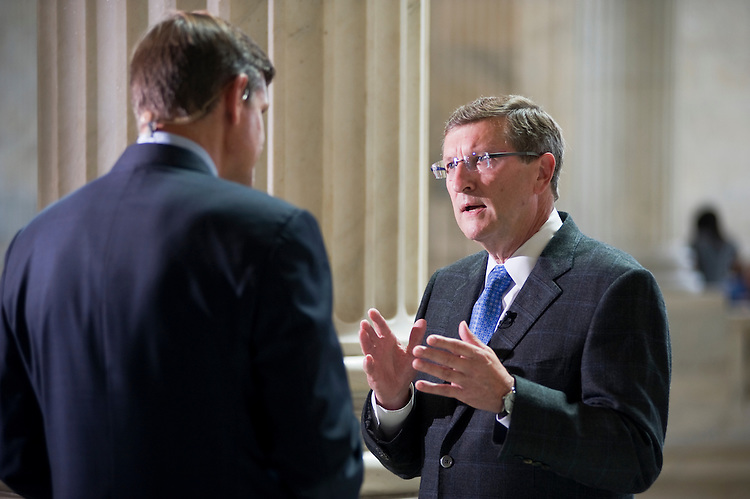 UNITED STATES - JULY 18: Sen. Kent Conrad, D-N.D., right, is interviewed by Bloomberg's Peter Cook, in the Russell rotunda. (Photo By Tom Williams/Roll Call)