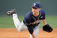 Starting pitcher Luke Curtis (13) of the University of Pittsburgh Panthers delivers in a game against the Presbyterian Blue Hose on Tuesday, March 11, 2014, at Fluor Field at the West End in Greenville, South Carolina. Pitt won, 12-3. (Tom Priddy/Four Seam Images)